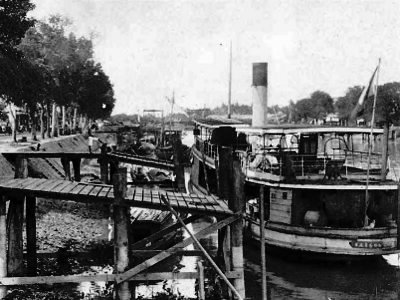 A steamer departing from Mỹ Tho and heading West towards the Mekong Delta