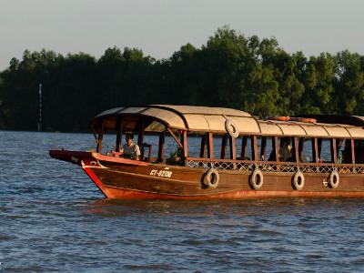 a Mystic sampan at sunset